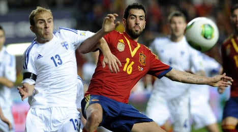 Champions Spain held at home by feisty Finland