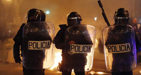 Riot police use numbers shield in ID game