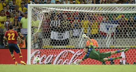 Penalty thriller puts Spain through to final