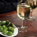 """""""For a really hot day, the best sherry is a chilled fino or Manzanilla, served in a white wine glass and with olives on the side,"""" says qualified sherry educator Annie Manson.  """"Have a sip of sherry, and then eat an olive. Then take another sip of sherry: you'll notice how the sherry changes to match the food. That's part of the sherry magic.""""Photo: goodiesfirst/flickr"""