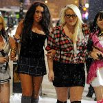"""Inappropriate winter dress: Miniskirts and skimpy tops when it's minus five degrees outside? Spaniards still hit the town in winter but they wrap up warm without fail. British youth's decision to brave it with the help of a much needed """"beer coat"""" baffles many Spaniards in the UK.Photo: Chewthefat"""