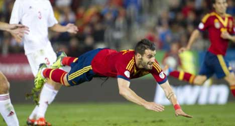 Bland Spain one point away from Brazil spot