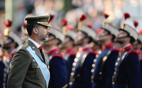 Prince presides over toned down national day