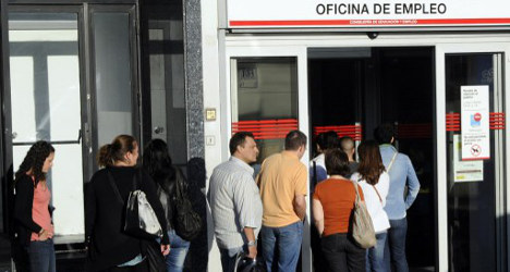 Spain's jobless rate falls by smallest of margins