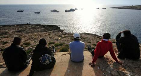 Kicked out of 'Spanish Rock': Africans fight back