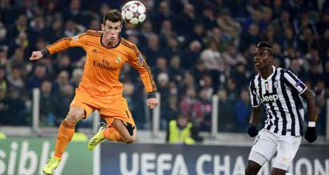 Real almost through after thrilling draw with Juve