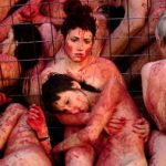'Bloody' activists strip down to protest fur
