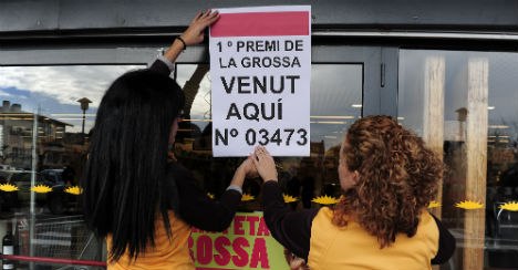 Catalans stage festive lottery to rival Spain's