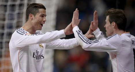 Ronaldo double keeps Real Madrid in title hunt