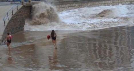 VIDEO: Dancing woman swept away by wave