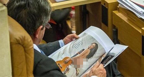 Politician caught viewing 'nudie pics' in parliament