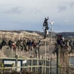 THURSDAY: Would-be immigrants from sub-Saharan spent much of Thursday six metres (20 feet) off the ground atop a border fence separating Morocco from the North African Spanish enclave of Melilla following a morning assault on the border in an attempt to cross into Spain.Photo: José Colón/AFP