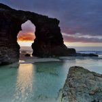 """PLAYA DE LAS CATEDRALES (GALICIA): A beach which encapsulates the wild, craggy coastline of Spain's most easterly region like no other. 'Cathedrals Beach' leaves visitors in awe of its gigantic arch-like rock formations and deep caves. """"How amazing mother nature is,"""" wrote one visitor on TripAdvisor. Make sure to find out when it's low tide to be able to explore the beach from ground level.Photo: Shutterstock"""