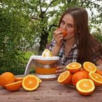 """MY HALF AN ORANGE: Unless you're with a gold-digger, there's no reason to think the person calling you 'mi media naranja' wants to bleed you or squeeze you dry. The expression means my better half or my soul mate. Photo: <a href=""""http://shutr.bz/1oa0z52"""">Woman eating oranges</a> - Shutterstock"""