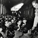 1955: 18-year-old prince Juan Carlos is warmly greeted by a crowd at a Madrid station. Juan Carlos was born  in Rome in 1938, but his exiled grandfather King Alfonso VIII convinced Spanish dictator Francisco Franco to allow the young Juan Carlos to return to Spain to complete his studies in 1948. Photo: AFP