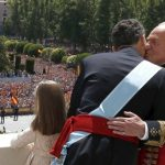 Felipe receives a kiss from kiss from his father Don Juan Carlos as thousands cheer them from Madrid's royal gardens. Photo: Javier Lizon/AFP