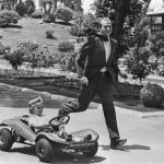 1975: Prince Juan Carlos of Spain plays with his son Don Felipe driving a cart, in the gardens of Zarzuela Palace in Madrid. Photo: AFP