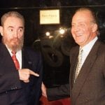1998: Cuban leader Fidel Castro jokes with King Juan Carlos on the eve of an Ibero American summit in Portugal. Photo: AFP