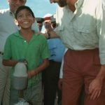 1998: Prince Felipe speaks with a Nicaraguan boy while visiting areas of Central America devastated by Hurricane Mitch.Photo: Miguel Alvarez/AFP