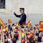 Spain's King Felipe VI waves on arrival to the Palacio de Oriente or Royal Palace in Madrid on June 19, 2014 following a swearing in ceremony of Spain's new King before both houses of parliament.Photo: Miguel Riopa/AFP