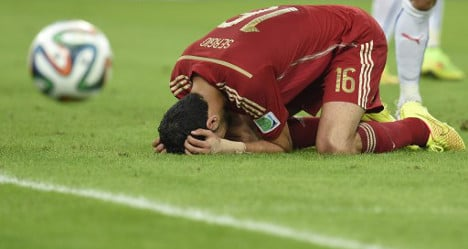 Spain crash out of World Cup after Chile loss