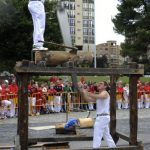Many people from Navarre share the same traditions as their Basque neighbours. Even though the region is technically not part of the Basque country, Euskera (Basque) is widely spoken and Basque sports such as log-chopping are commonly practised during San Fermin. Photo: Ander Guillenea/AFP