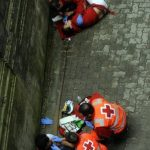 When the bull run goes wrong: Medics treat two participants who fell in front of the beastsPhoto: Rafa Rivas/AFP