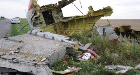 Spain calls for answers on Malaysian jet crash