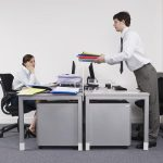 """<b>Escurrir el bulto:</b> To pass the buck. When someone cheekily passes off work or responsibilities to other colleagues in the workplace, they 'drain the lump' (as weird as it many sound) in Spanish. Photo: <a href=""""http://shutr.bz/1qXM8o7"""">Photo of office worker passing work off to colleague: Shutterstock</a>"""