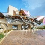 """FRANK GEHRY'S HOTEL MARQUÉS DE RISCAL, LA RIOJA. This architectural masterpiece by the man who created the Guggenheim Museum in Bilbao is in the middle of Spain's world-famous wine region. Visit one of La Rioja's 1,200 wineries after the early-autumn grape harvest then sip a glass of something good at sunset while admiring the hotel's undulating lines.Photo: <a href=""""http://www.shutterstock.com/"""">Shutterstock</a>"""