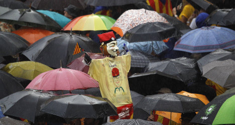 Catalans take to streets to back vote on self-rule