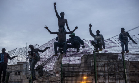 Migrants scale Spain's border fence at Melilla