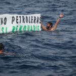 Protesters strip off to oppose Repsol plans