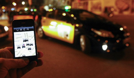 Taxi app Uber defies ban in Spain after ruling
