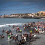 Horse riders gather on Enramada beach along the southern Adeje coastline on the Canary island of Tenerife, on January 20th, to celebrate the festival of Saint Sebastian, patron protector of animals against pests and disease. Photo: Desiree Martin/AFP