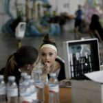 A contestant for Child Queen has her makeup applied backstage during the Santa Cruz carnival. Photo: AFP