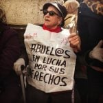 """""""Grandparents fighting for their rights!"""" - an older Podemos supporter having a rest among the busy scenes in central Madrid. Photo: Jessica Jones"""