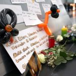 Condolence messages for the victims of the Germanwings plane crash are fixed on a pole in the departure area of the airport Duesseldorf