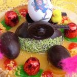 """<b>Mona de Pascua.</b> Especially popular in Catalonia and Valencia, this cake is traditionally given to children as a gift. Cakes are topped with either boiled eggs, or chocolate ones, as well as colourful decorations.Photo: Photo: <a href=""""http://bit.ly/1CBUhEO"""">Alex Castellá</a>/Wikipedia Commons"""