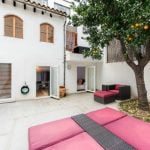 """3 - Triplex apartment with three private terraces in the heart of the old city that was completely refurbished in 2014. Comes with its own orange tree. Price: €890,000  Photo: <a href=""""http://www.portamallorquina.com/property/palma-de-mallorca-old-town-apartment-106807.html""""> Offered by Porta Mallorquina</a>"""
