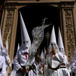 The colours of the robes worn by penitents depend on which brotherhood they belong to. Here, members of the Borriquita brotherhood parade during celebrations marking the feast of Palm Sunday in Seville on March 29th. Photo: Cristina Quicler/AFP