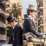 """Men ride in a carriage dressed in the traditional <i>traje corto</i>, or short suit consisting of a short jacket, tight trousers, boots and a wide-brimmed hat.Photo: <a href=""""http://bit.ly/1HKsHHB"""">Javier Prieto</a> / Flickr Creative Commons."""