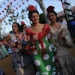 Women walk through the streets in the traditional flamenco-style dresses.Photo: Cristina Quicler / AFP.