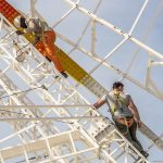 """Men work to set up the famous ferris wheel in preparation for the April fair.Photo: <a href=""""http://bit.ly/1bjnSZL"""">Javier Prieto</a> / Flickr Creative Commons."""