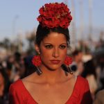 A woman wears the traditional flamenco-style costume for the April Fair.Photo: Cristina Quicler / AFP.
