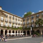 """<b>Plaza Nueva, Bilbao.</b> Also known as Plaza Barrio, this plaza is built in the Neoclassical style and is home to traditional taverns, restaurants and a flea market where ancient books, coins and stamps are sold.Photo: <a href=""""http://bit.ly/1ModsUy"""">Jose Mario Pires</a> / Wikimedia Commons."""