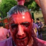 """A man is covered in wine during the """"Batalla del Vino"""".Photo: Cesar Manso/AFP"""
