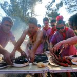 """Covered in wine, revellers prepare """"chorizo"""" (spicy pork sausage) and """"morcilla"""" (blood sausage) during the """"Batalla del Vino"""".Photo: Cesar Manso/AFP"""