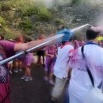 """A man sprays red wine on revellers during the """"Batalla del Vino"""".Photo: Cesar Manso/AFP"""
