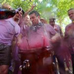 """Revellers pour wine on a drum during the """"Batalla del Vino"""".Photo: Cesar Manso/AFP"""